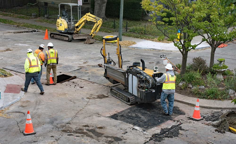 A crew installing a utility using directional drilling rig